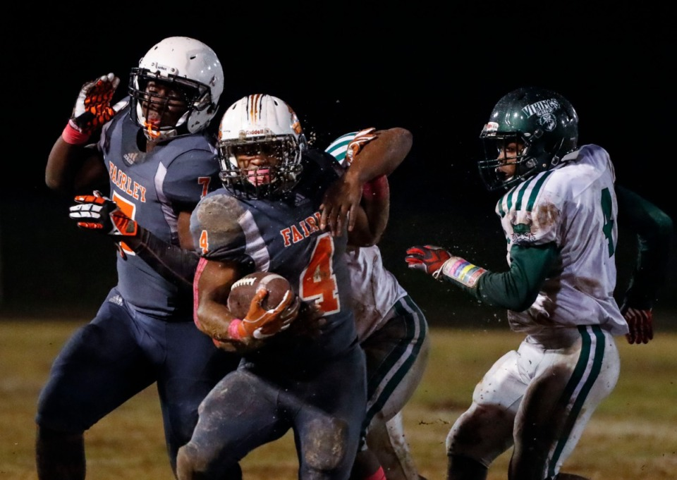 <strong>Fairley running back Terry Wilkins (with ball) scrambles in the game against Hillcrest Oct. 25.</strong> (Mark Weber/Daily Memphian)