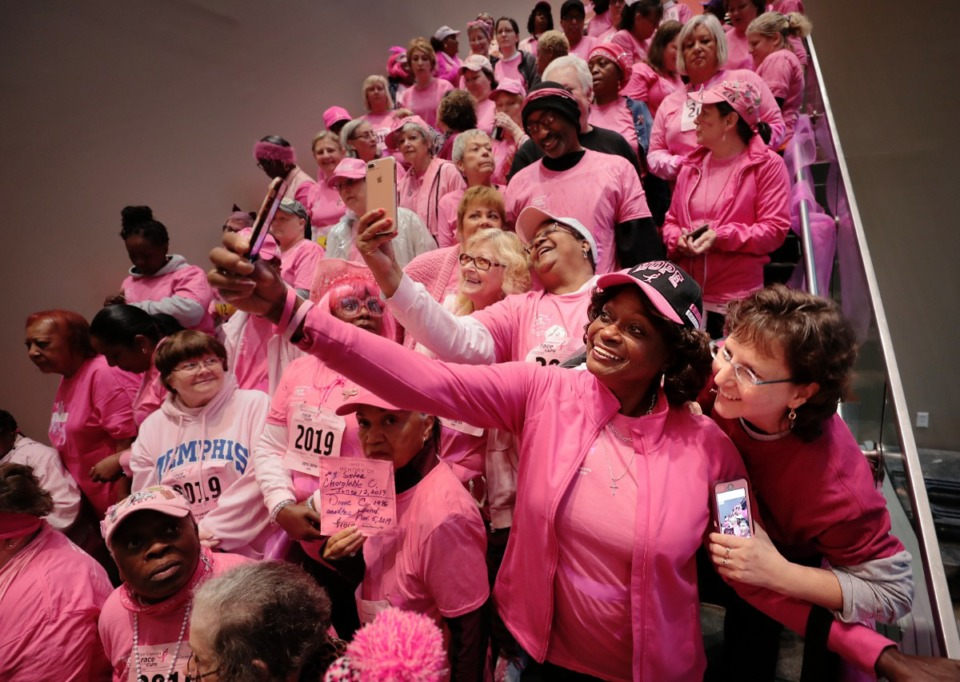<strong>Rena Rosenberg (right) and Levoyd Thomas take a selfie as breast cancer survivors gather for a group photo before the start of the annual Susan G. Komen Race for the Cure.</strong> (Jim Weber/Daily Memphian)