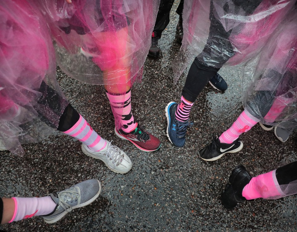 <strong>Runners show off their colorful socks as breast cancer survivors, dedicated friends and family gather Downtown.</strong> (Jim Weber/Daily Memphian)