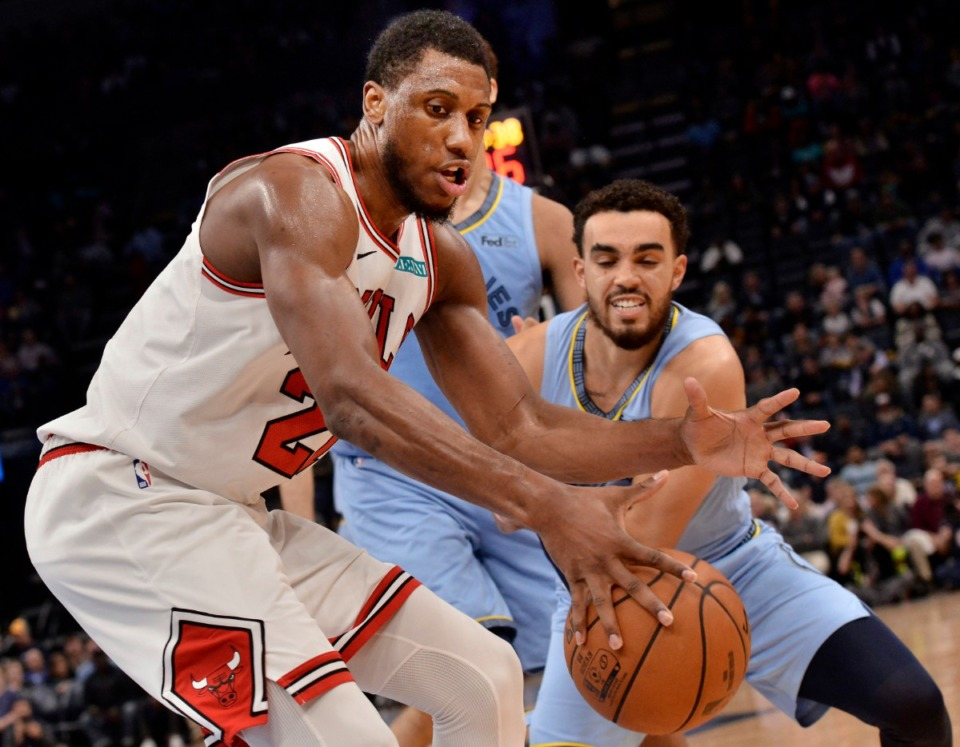 <strong>Chicago Bulls forward Thaddeus Young (left), controls the ball against Memphis Grizzlies guard Tyus Jones in the second half of an NBA basketball game Friday, Oct. 25 at FedExForum.&nbsp;</strong>(Brandon Dill/AP)