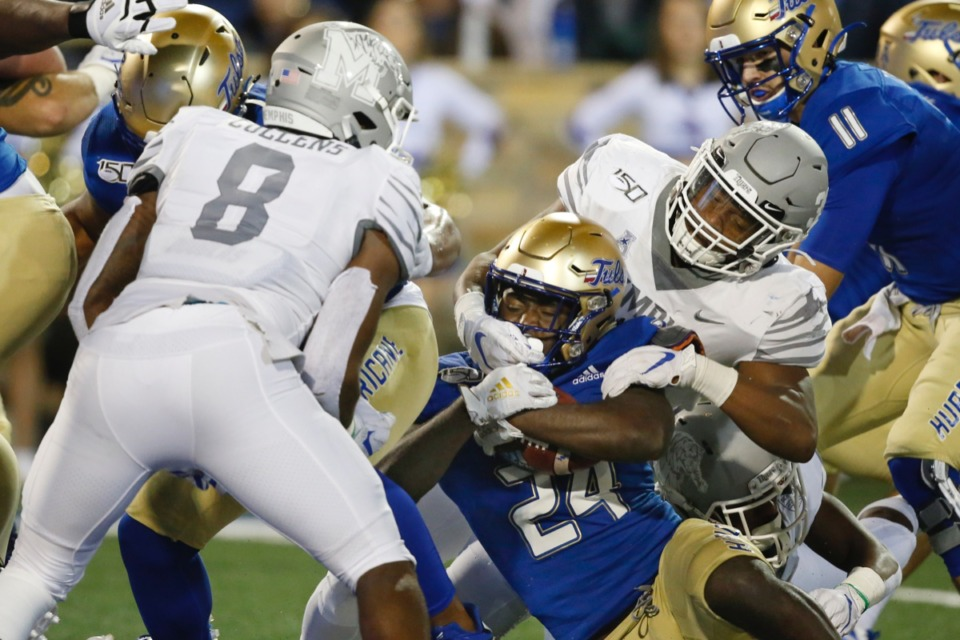 <strong>Tulsa running back Corey Taylor II (24) is taken down by Memphis Tigers Xavier Cullens (8) and Tim Hart (right), but falls into the end zone to score Oct. 26. The Tigers went on to win the game, which probably cemented the GameDay appearance.</strong> (AP Photo/Sue Ogrocki)