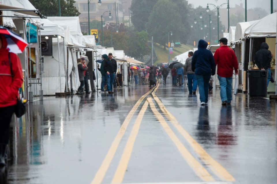<strong>Rain and mist kept the crowds light at the River Arts Festival on Riverside Drive Saturday, October 26, 2019.</strong> (Greg Campbell/Special for The Daily Memphian)