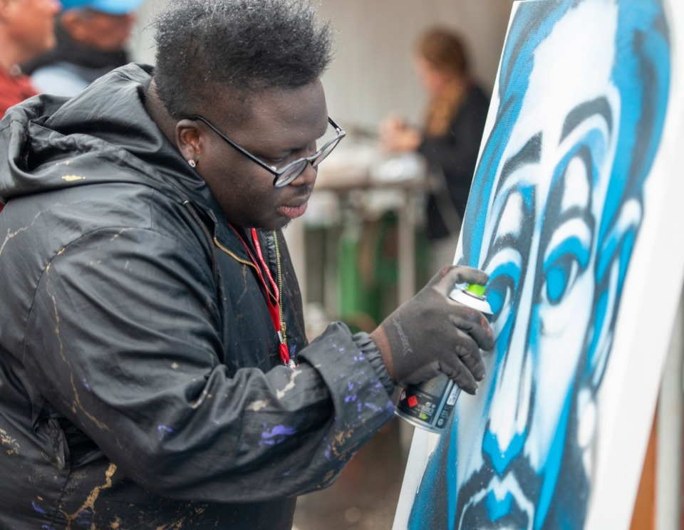 <strong>Memphis spray paint artist Toonky Berry demonstrates his process of painting at the River Arts Festival on Riverside Drive Saturday, October 26, 2019.</strong> (Greg Campbell/Special for The Daily Memphian)