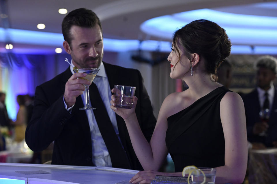 """<strong>Jake (Barry Sloane) and Sydney (Caitlin McGee) toast at the Peabody Hotel in """"Bluff City Law.""""</strong> (Katherine Bomboy/NBC)"""
