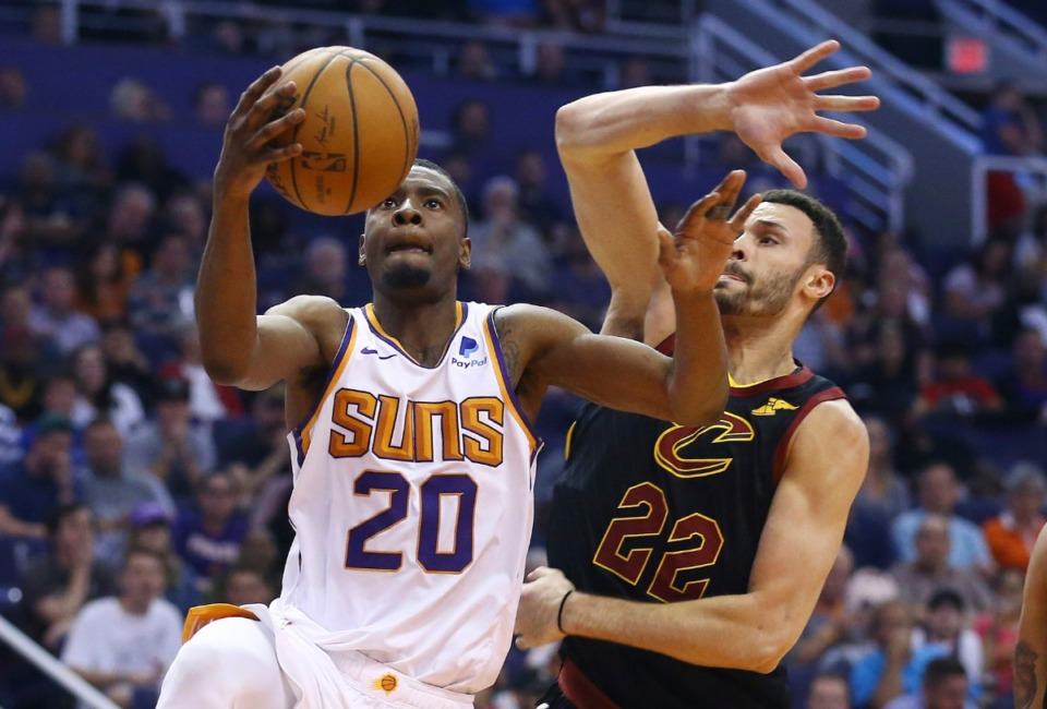 <strong>Phoenix Suns forward Josh Jackson (20) drives past Cleveland Cavaliers forward Larry Nance Jr. (22) on April 1. &ldquo;Now I&rsquo;m here, and I got a deck of cards and I gotta play &rsquo;em,&rdquo; he said.</strong>&nbsp;(Ross D. Franklin/AP)