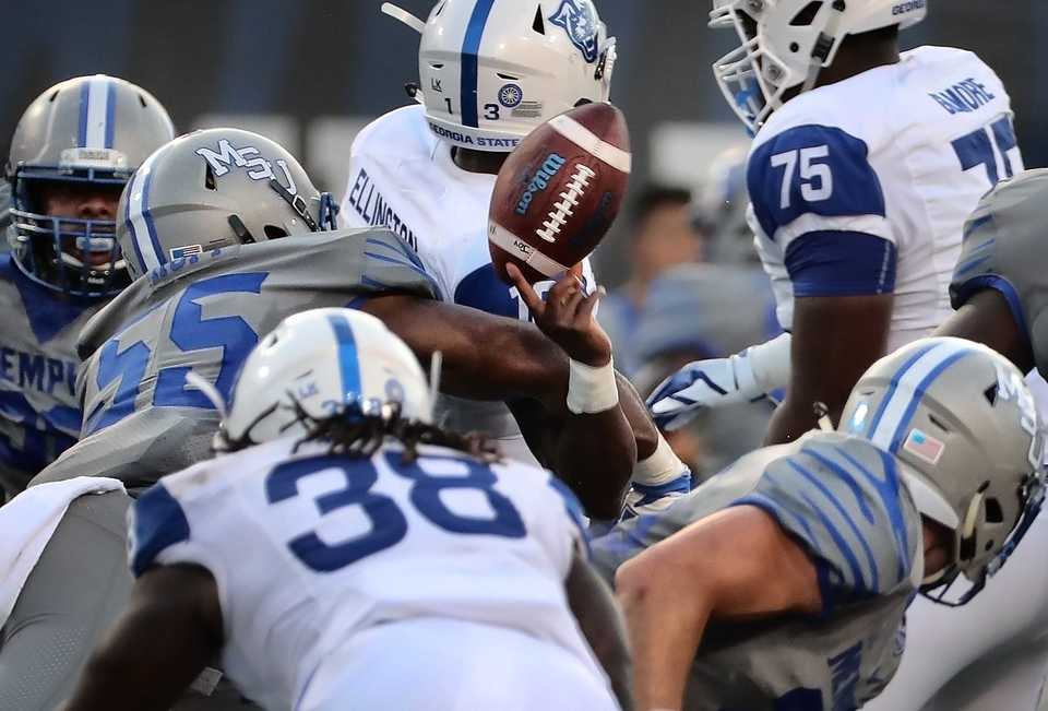 <strong>Tiger's linebacker Bryce Huff knocks the ball loose from Georgia quarterback Dan Ellington during the Tiger's game against Georgia State at the Liberty Bowl Memorial Stadium on September 14, 2018. The University of Memphis beat Georgia 59-22.</strong> (Jim Weber/Daily Memphian)