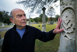 "<strong>Memphis photographer Murray Riss admires the detail of the Jewish Tree of Life symbol on the gravestone of Gabriel Baum, who was buried in 1885, while visiting Temple Israel Cemetery in South Memphis on Oct. 29, 2019. The 78 year old took 12,000 images over the four seasons of one year at the cemetery, and 200 photos are featured in the new book ""Beloved.""</strong> (Patrick Lantrip/Daily Memphian)"