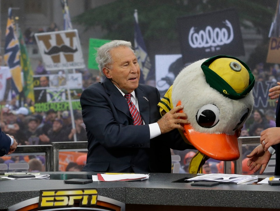 <strong>ESPN College GameDay host Lee Corso puts on the mascot head of the Oregon Ducks as he makes his prediction of an Oregon win over Washington in an NCAA college football game, Saturday, Oct. 12, 2013. Corso and the rest of the GameDay show will be on Beale Street Saturday morning.</strong> (AP Photo/Ted S. Warren)