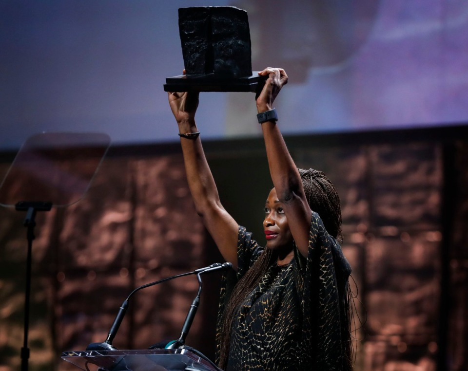 <strong>Honoree Hafsat Abiola raises her 2019 Freedom Award to honor her parents at the Orpheum Oct. 30.</strong> (Mark Weber/Daily Memphian)
