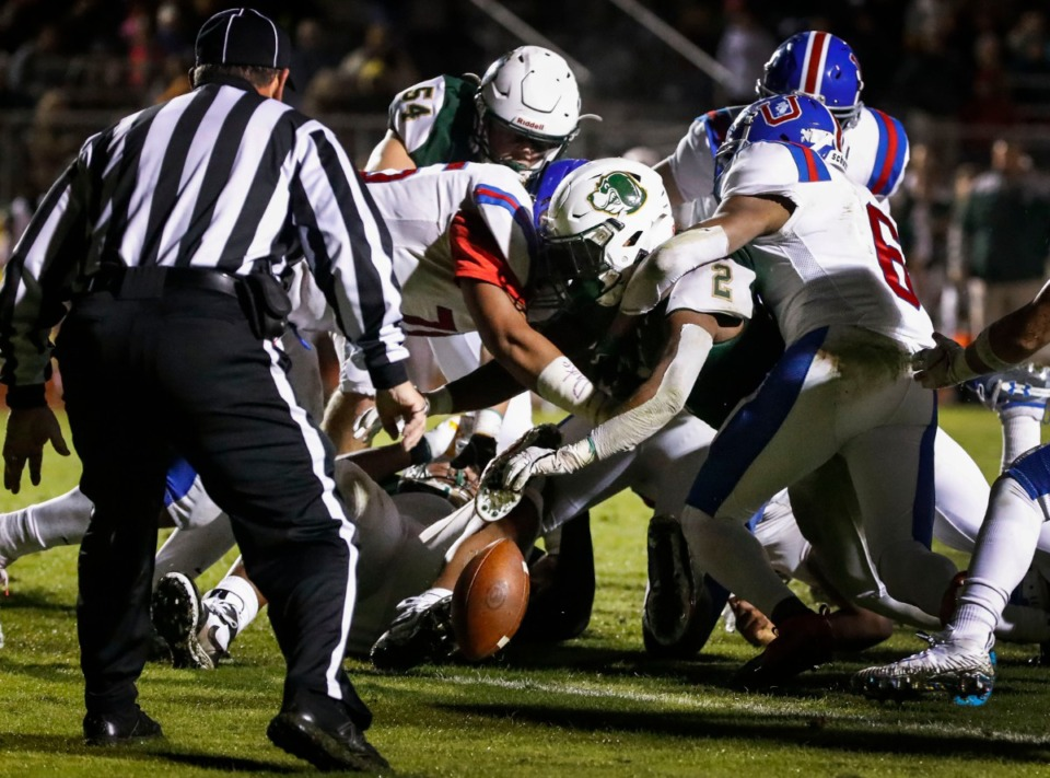 <strong>Briarcrest running back Jabari Small (center) fumbles the ball at the goal line in the game against MUS Nov. 1.</strong> (Mark Weber/Daily Memphian)