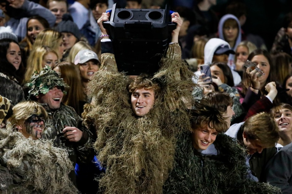 <strong>MUS students celebrate a touchdown while dancing to a portable speaker in the game&nbsp; against Briarcrest Nov. 1.</strong> (Mark Weber/Daily Memphian)