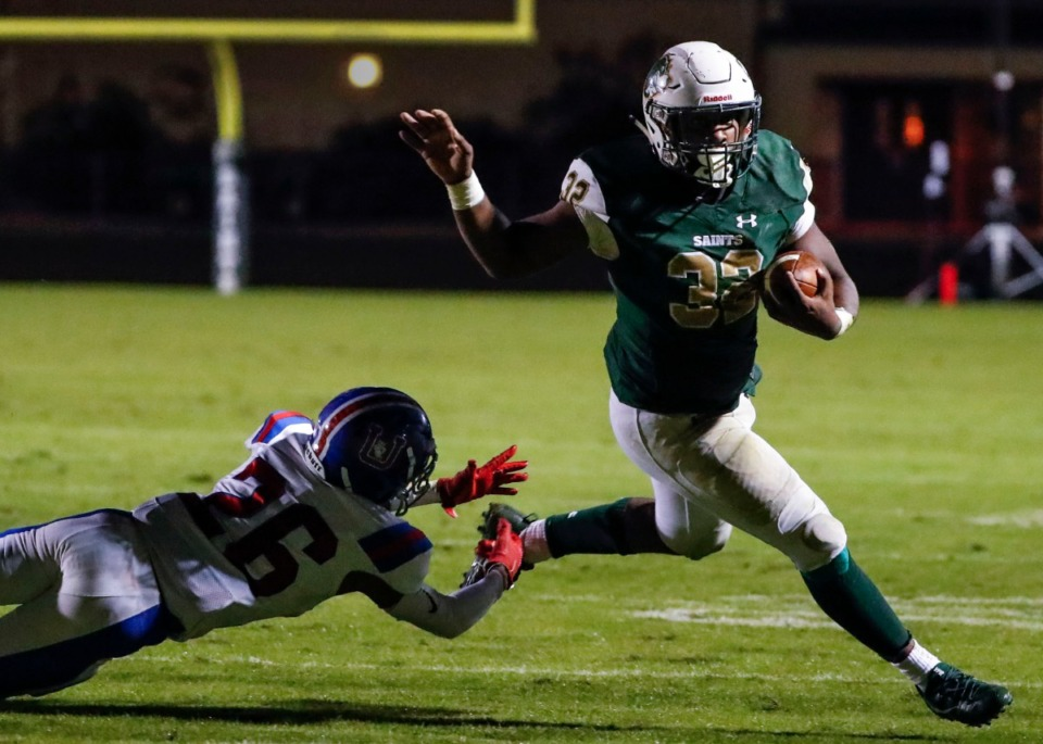 <strong>Briarcrest running back Marlon Hampton (with ball) scrambles past MUS defender Hunter Barnes (left) for a touchdown Nov. 1.</strong> (Mark Weber/Daily Memphian)