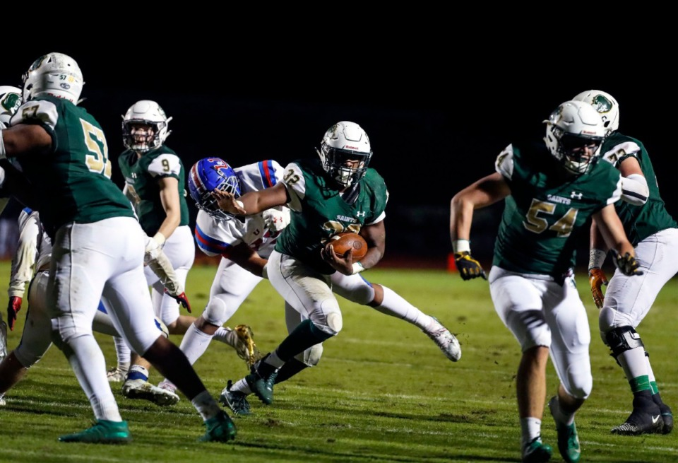 <strong>Briarcrest running back Marlon Hampton (with ball) scrambles past the MUS defense for a touchdown Nov. 1.</strong> (Mark Weber/Daily Memphian)