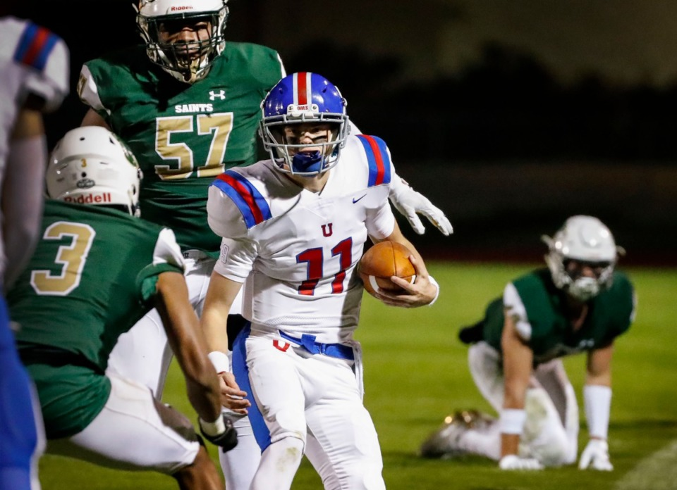 <strong>MUS quarterback Edwin Shy (with ball) fights for yardage in the game against Briarcrest Nov. 1.</strong> (Mark Weber/Daily Memphian)