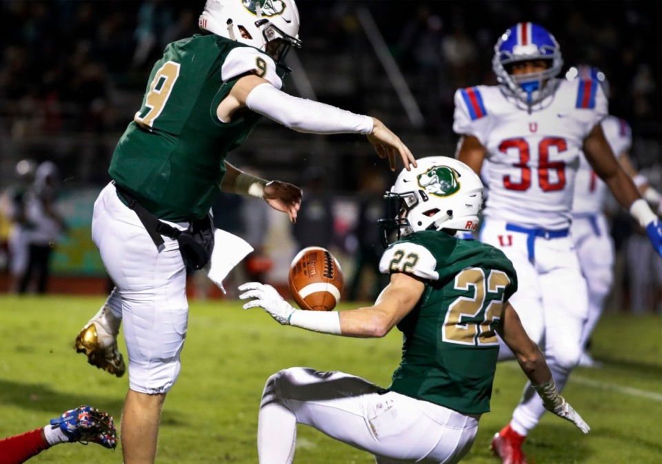 <strong>Briarcrest quarterback Michael Dallas (left) fumbles the ball after running into teammate Gunner Campbell (kneeling) in the game against MUS Nov. 1.</strong> (Mark Weber/Daily Memphian)