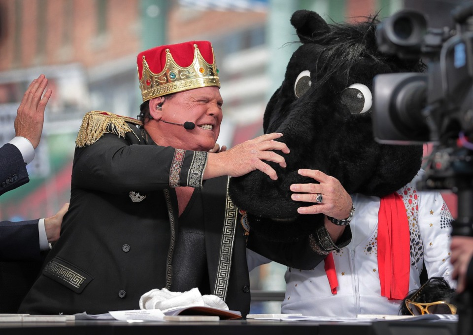 """<strong><span>Memphis wrestler Jerry Lawler reacts as """"ESPN College GameDay""""&nbsp; host Lee Corso dons the mascot head of SMU, picking the Mustangs over the Tigers for Saturday night's matchup between the two nationally ranked AAC teams.&nbsp;</span>The network broadcast """"GameDay"""" live from Beale Street on Nov. 2, 2019.</strong> (Jim Weber/Daily Memphian)"""