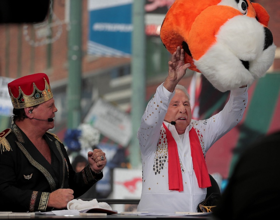 """<strong>Memphis wrestler Jerry Lawler (left) reacts as ESPN's """"College GameDay"""" host Lee Corso tosses the Pouncer mascot, picking the Mustangs over the Tigers for Saturday night's matchup between the two nationally ranked AAC teams. The network broadcast """"GameDay"""" live from Beale Street on Nov. 2, 2019.</strong> (Jim Weber/Daily Memphian)"""