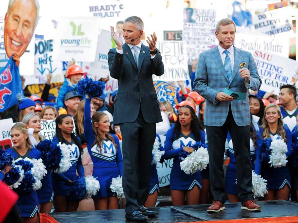 """<strong>University of Memphis head football coach Mike Norvell (left) takes the stage with host Tom Rinaldi during the broadcast of ESPN's """"College GameDay"""" live from Beale Street on Nov. 2, 2019.</strong> (Jim Weber/Daily Memphian)"""