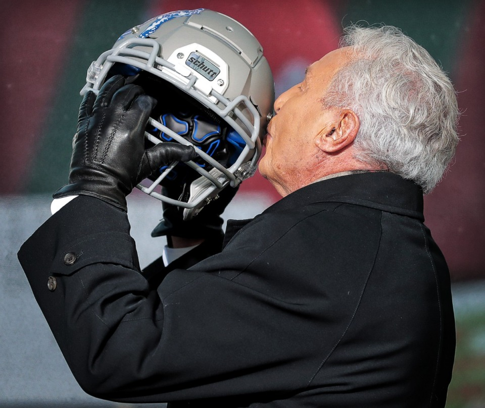 """<strong>GameDay host Lee Corso embraces the University of Memphis helmet as Tigers football fans pack Beale Street during the live broadcast of ESPN's """"College GameDay"""" on Nov. 2, 2019.</strong> (Jim Weber/Daily Memphian)"""