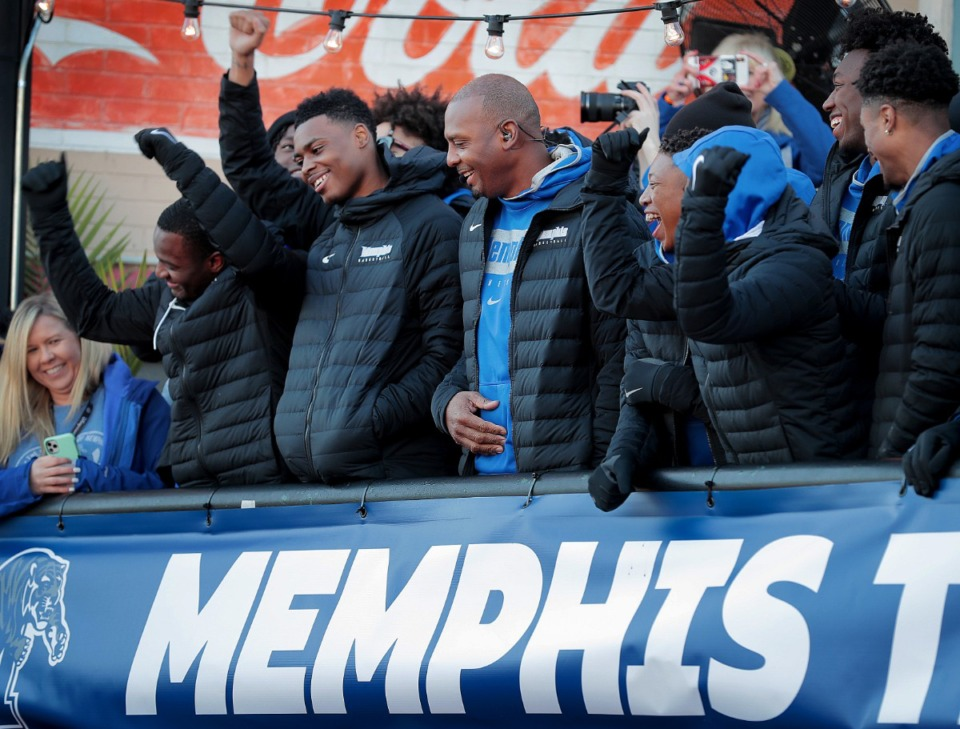 """<strong>University of Memphis head basketball coach Penny Hardaway (center) and his team get an ovation from Tigers football fans packed onto Beale Street during the live broadcast of ESPN's """"College GameDay"""" on Nov. 2, 2019.</strong> (Jim Weber/Daily Memphian)"""
