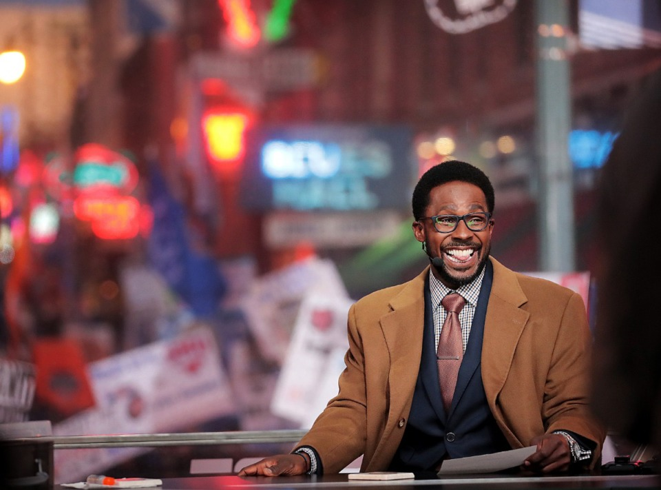 """<strong>Host Desmond Howard jokes around on a commercial break as Tigers football fans pack Beale Street during the live broadcast of ESPN's """"College GameDay"""" on Nov. 2, 2019.</strong> (Jim Weber/Daily Memphian)"""