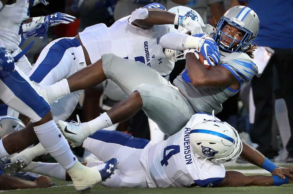 <strong>Tiger's running back Darrell Henderson is brought down on a long run during the Tiger's game against Georgia State at the Liberty Bowl Memorial Stadium on September 14, 2018. The University of Memphis beat Georgia 59-22.</strong> (Jim Weber/Daily Memphian)