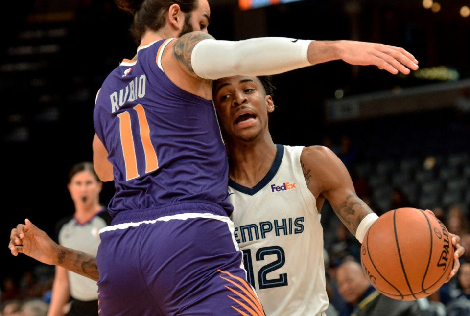 <strong>Memphis Grizzlies guard Ja Morant (12) drives against Phoenix Suns guard Ricky Rubio (11) in the first half of their game Saturday, Nov. 2, 2019, in Memphis.</strong> (AP Photo/Brandon Dill)