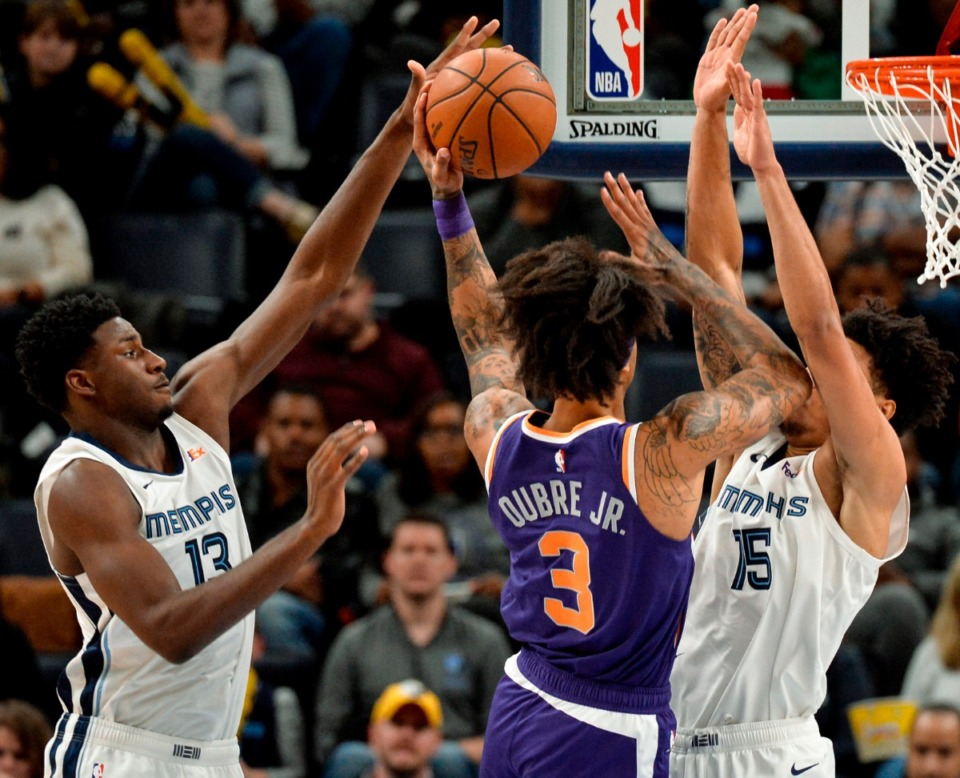 <strong>Memphis Grizzlies forward Jaren Jackson Jr. (13) blocks Phoenix Suns forward Kelly Oubre Jr. (3) who shoots against Grizzlies forward Brandon Clarke (15) in the first half of an NBA basketball game Saturday, Nov. 2, 2019, in Memphis, Tenn</strong>. (AP Photo/Brandon Dill)