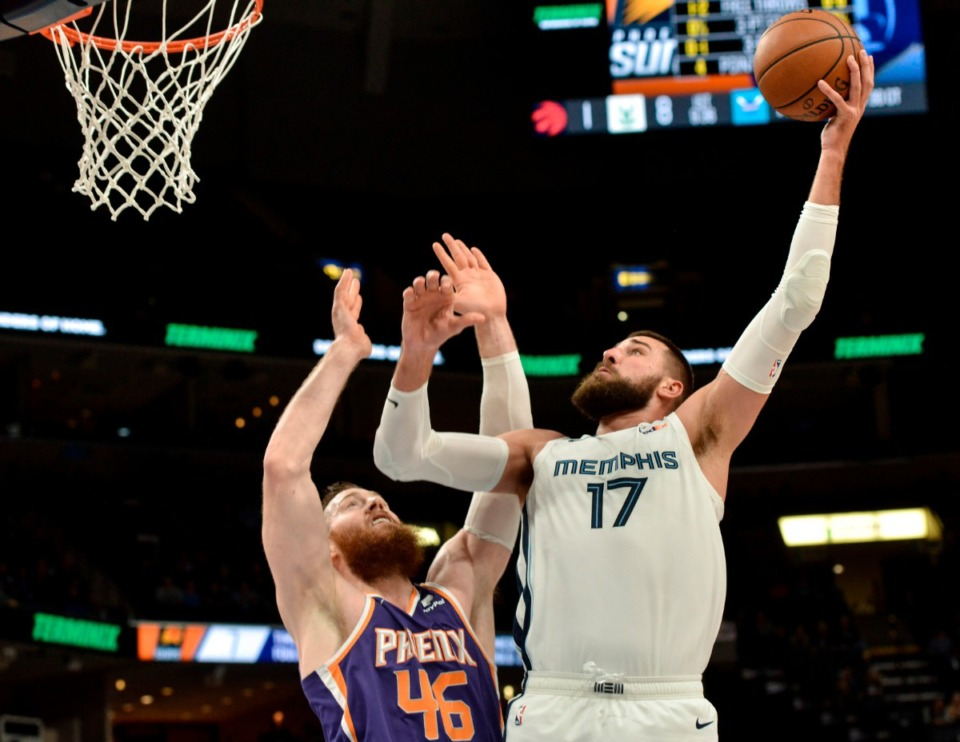 <strong>Memphis Grizzlies center Jonas Valanciunas (17) shoots against Phoenix Suns center Aron Baynes (46) in the first half of an NBA basketball game Saturday, Nov. 2, 2019, in Memphis, Tenn.</strong> (AP Photo/Brandon Dill)