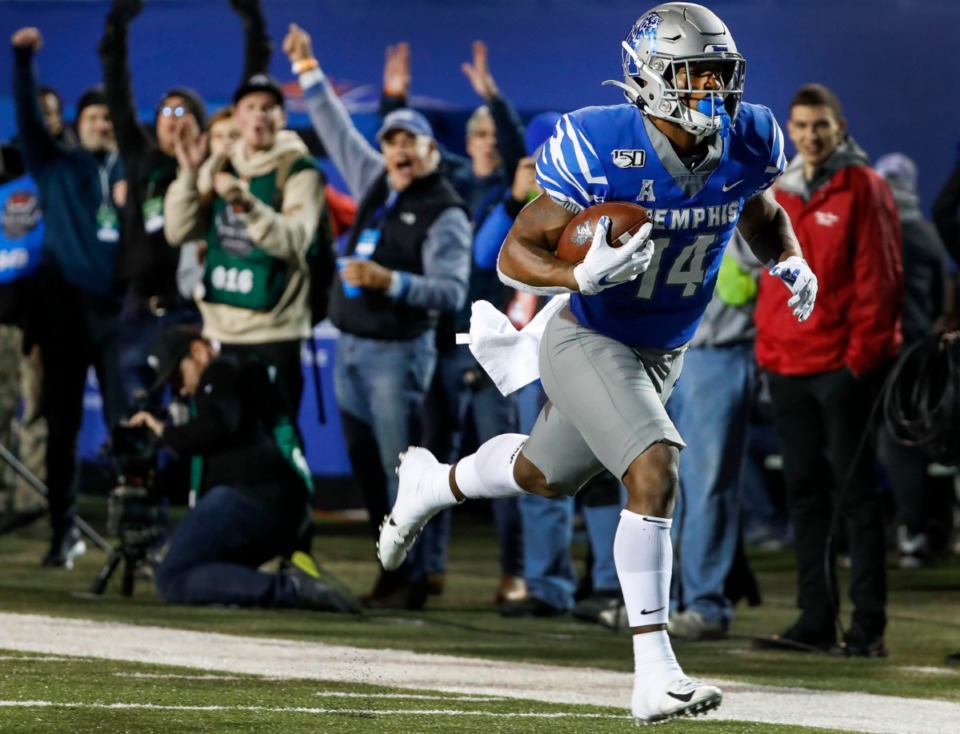 <strong>University of Memphis fans celebrate as running back Antonio Gibson scores a touchdown against SMU during their matchup on Saturday, Nov. 2, 2019, at Liberty Bowl Memorial Stadium.&nbsp;</strong>&nbsp;(Mark Weber/Daily Memphian)