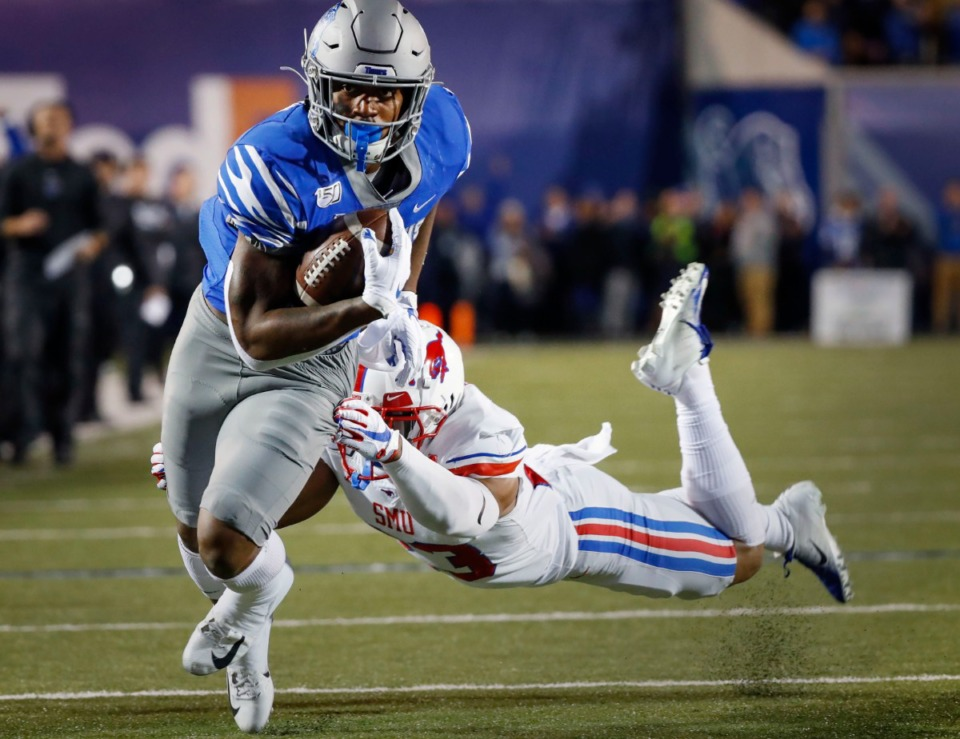<strong>University of Memphis running back Antonio Gibson (left) breaks away from SMU defender Rodney Clemons (right)&nbsp;during the game Saturday, Nov. 2, 2019 at Liberty Bowl Memorial Stadium. </strong>&nbsp;(Mark Weber/Daily Memphian)
