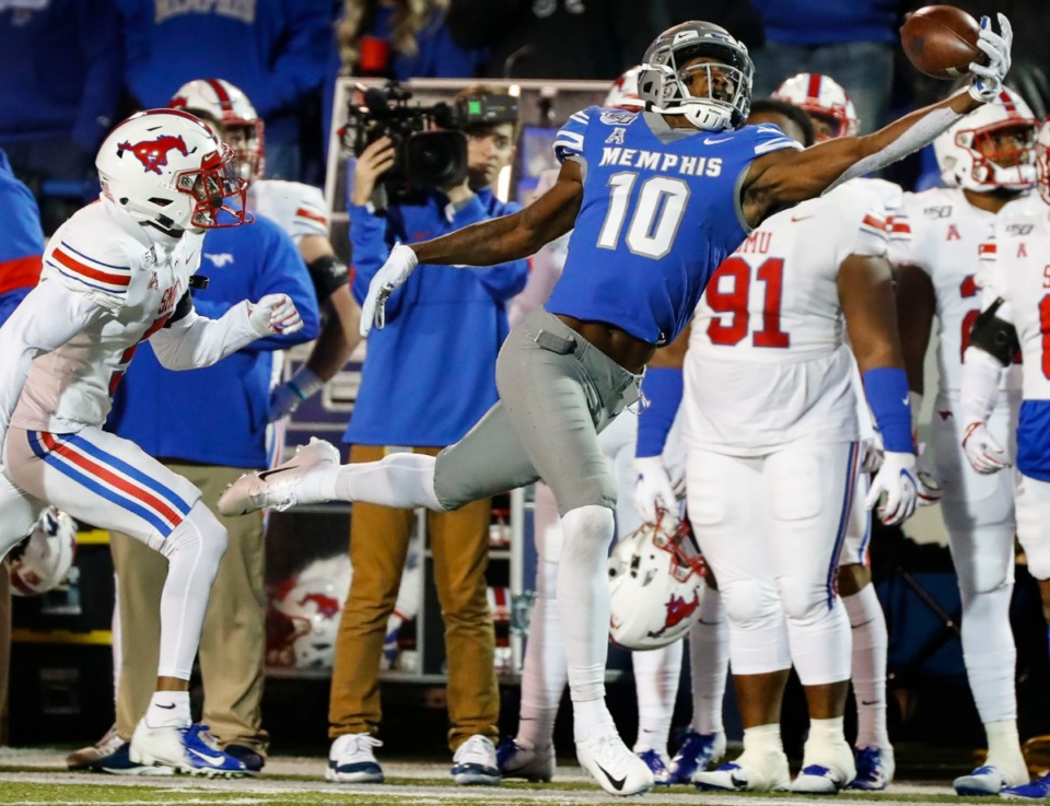 <strong>University of Memphis receiver Damonte Coxie (right) grabs a first down catch in front of the SMU bench&nbsp;during the game Saturday, Nov. 2, 2019 at Liberty Bowl Memorial Stadium. </strong>&nbsp;(Mark Weber/Daily Memphian)