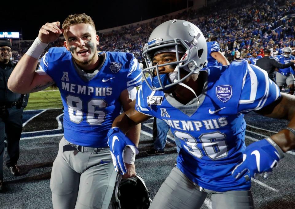 <strong>University of Memphis teammates Joey Magnifico (left) and Ladarius Jordan (right) celebrate a 54-48 victory over SMU Saturday, Nov. 2, 2019, at Liberty Bowl Memorial Stadium.</strong> (Mark Weber/Daily Memphian)