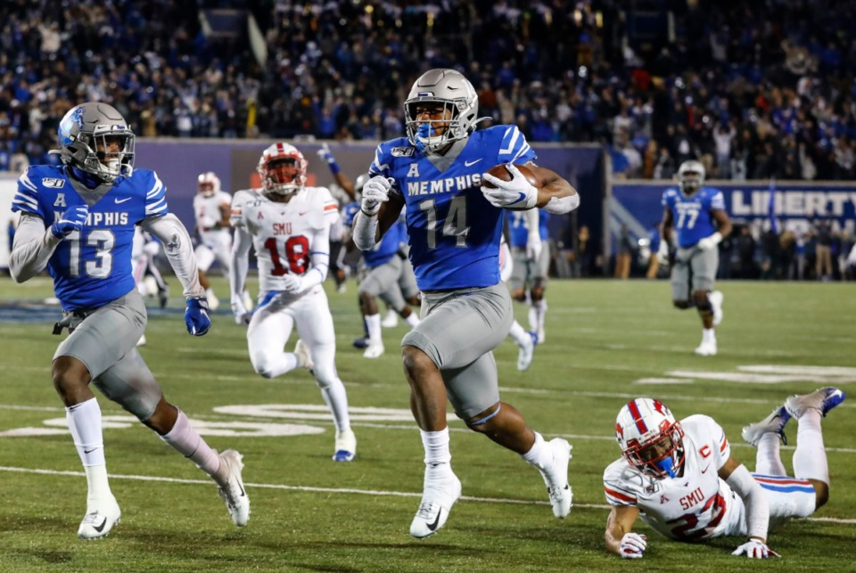 <strong>University of Memphis receiver Antonio Gibson (middle) runs by the SMU defense for a touchdown during the game Saturday, Nov. 2, 2019, at Liberty Bowl Memorial Stadium.</strong> (Mark Weber/Daily Memphian)