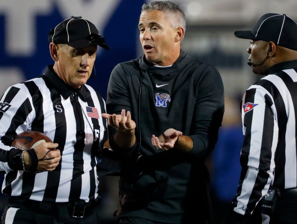 <strong>University of Memphis head coach Mike Norvell (middle) argues a call with the officials during the game against SMU Saturday, Nov. 2, 2019, at Liberty Bowl Memorial Stadium.</strong> (Mark Weber/Daily Memphian)
