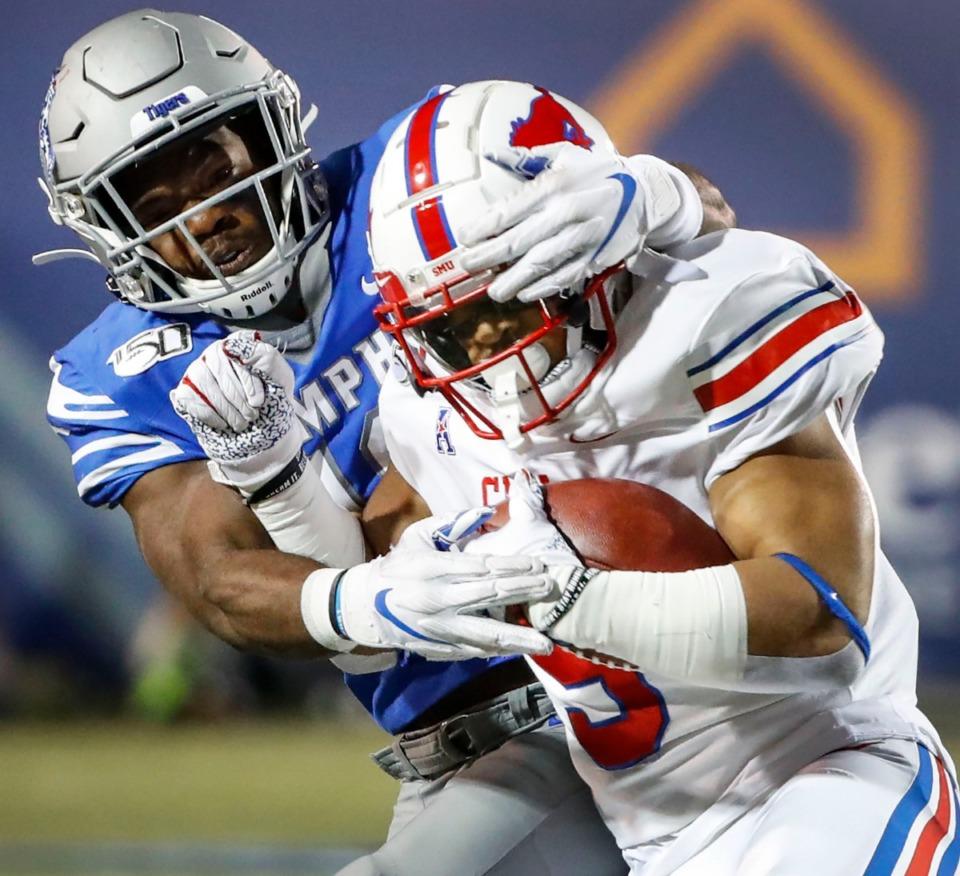 <strong>Memphis defender Thomas Pickens (back) tackles SMU running back Xavier Jones during the game Saturday, Nov. 2, 2019 at Liberty Bowl Memorial Stadium.</strong> (Mark Weber/Daily Memphian)