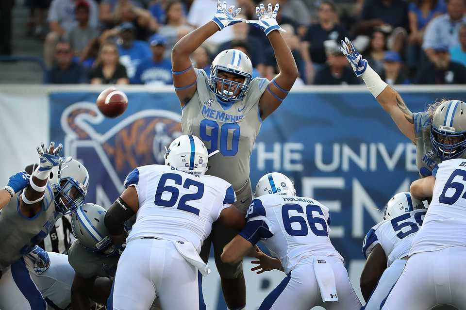 <strong>Tiger's lineman John Tate IV (90) tries to get a hand on Georgia's field goal attempt in the first half of the Tiger's game against Georgia State at the Liberty Bowl Memorial Stadium on September 14, 2018. The University of Memphis beat Georgia 59-22.</strong> (Jim Weber/Daily Memphian)