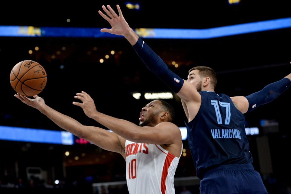 <strong>Houston Rockets guard Eric Gordon (10) shoots against Grizzlies center Jonas Valanciunas (17) Nov. 4 at FedExForum.</strong> (Brandon Dill/AP)