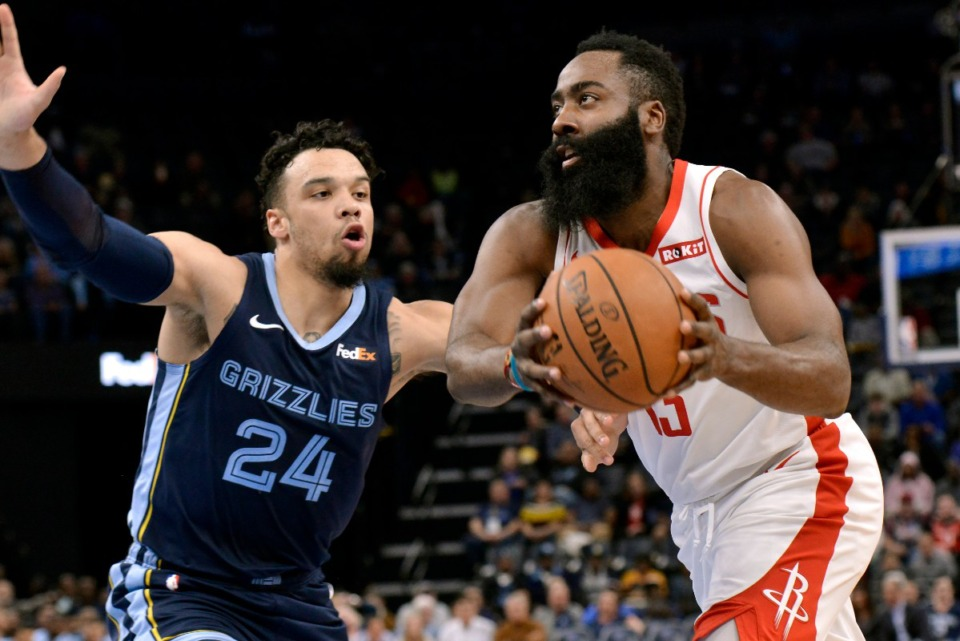 <strong>Houston Rockets guard James Harden (13) drives against Grizzlies guard Dillon Brooks (24) Nov. 4.</strong> (Brandon Dill/AP)