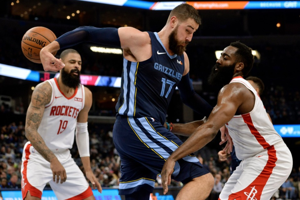 <strong>Houston Rockets guard James Harden (right) knocks the ball away from Grizzlies center Jonas Valanciunas (17), assisted by&nbsp;Rockets center Tyson Chandler (19) Nov. 4.</strong> (Brandon Dill/AP)