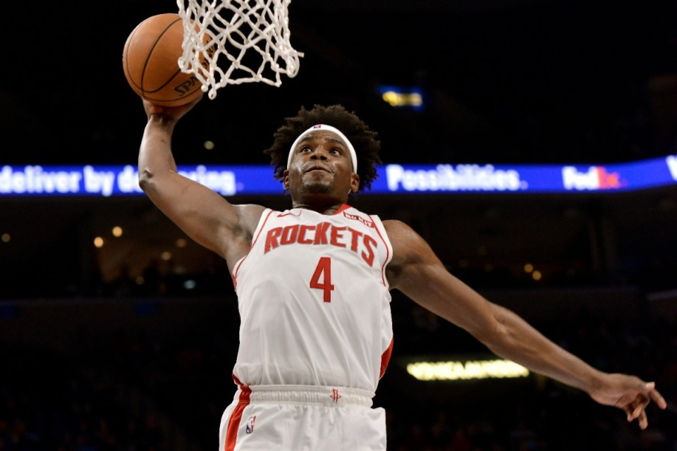 <strong>Houston Rockets forward Danuel House Jr. (4) dunks against the Grizzlies Nov. 4.</strong> (Brandon Dill/AP)