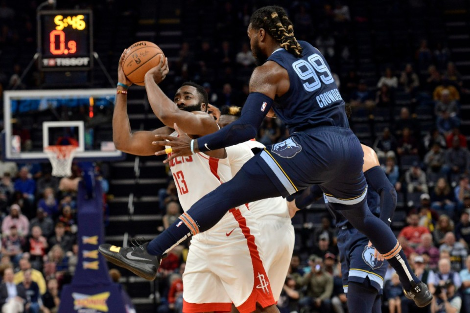 <strong>Houston Rockets guard James Harden (13) shoots against Grizzlies forward Jae Crowder (99) Nov. 4.</strong> (Brandon Dill/AP)