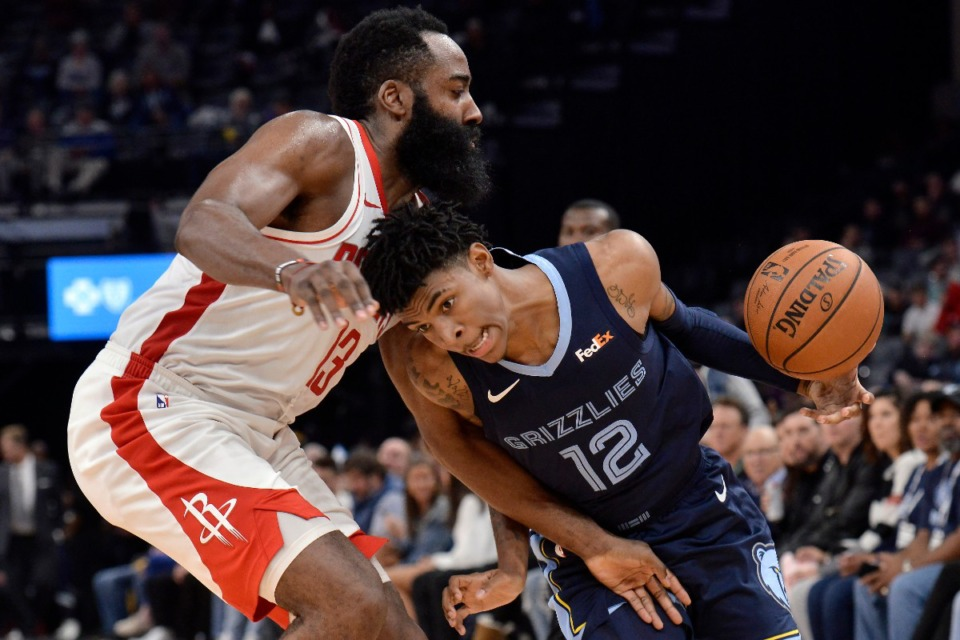 <strong>Memphis Grizzlies guard Ja Morant (12) drives against Houston Rockets guard James Harden (13) Nov. 4.</strong> (Brandon Dill/AP)