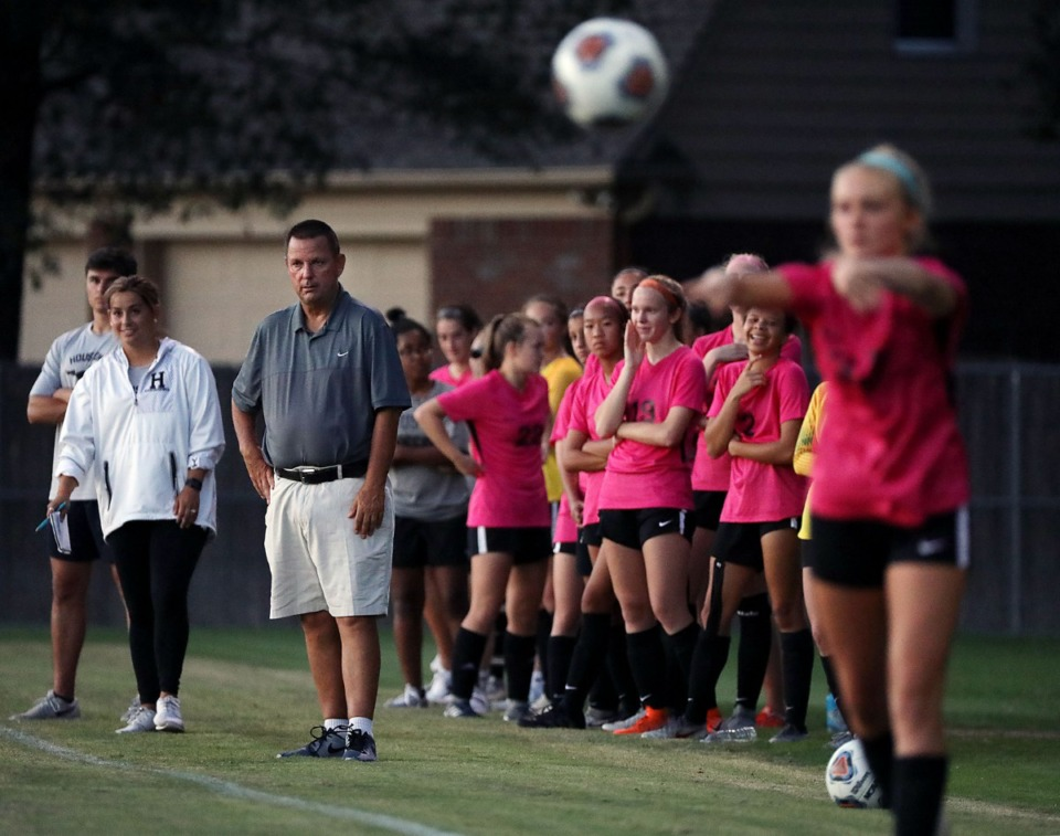 <strong>Houston High School girls soccer coach David Wolff (watching his players during a home game, Aug. 28) and his Mustangs will be the team to beat in Murfreesboro.</strong> (Patrick Lantrip/Daily Memphian)