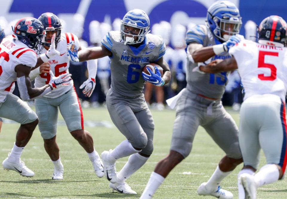 <strong>Memphis running back Patrick Taylor Jr. (middle) scrambles past the Ole Miss defense for positive yards during action in their NCAA football game at the Liberty Bowl Memorial Stadium on Aug. 31, 2019. Taylor is progressing in his rehab after injuring his foot in week one of the regular season.</strong> (Mark Weber/Daily Memphian)
