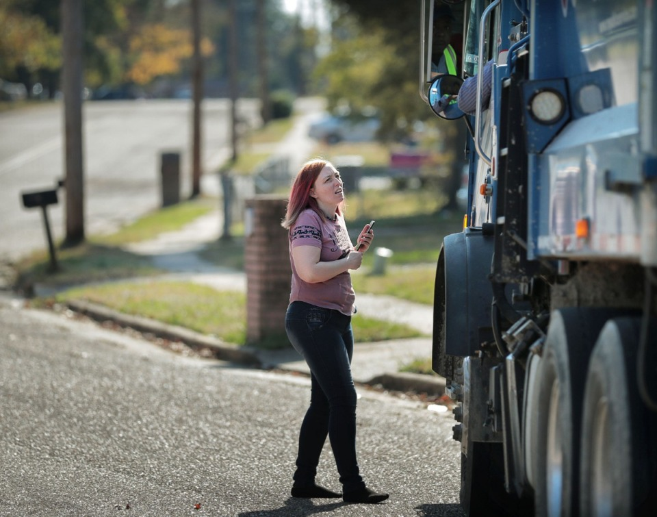 <strong>April Dill asks the garbage collector with Republic Services about getting a new trash can near her home in Northaven&nbsp; Nov. 5. Shelby County's public works division held a community meeting in Northaven Tuesday to gather feedback on its proposed blight and trash program for the area.</strong> (Jim Weber/Daily Memphian)