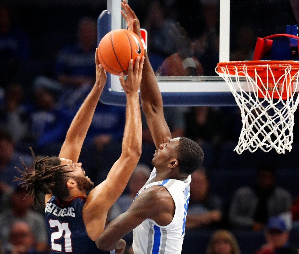 <strong>Lance Thomas (right) blocks South Carolina State forward David Bottenberg Nov. 5 at FedExForum.</strong> (Mark Weber/Daily Memphian)