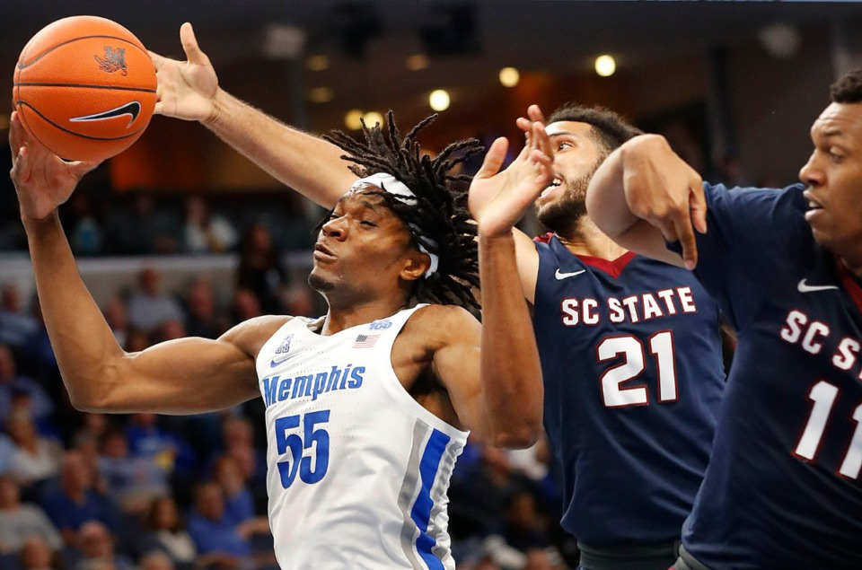 <strong>Forward Precious Achiuwa (left) battles South Carolina State's David Bottenberg (middle) and Armani Hill (right) for a rebound Nov. 5 at FedExForum.</strong> (Mark Weber/Daily Memphian)