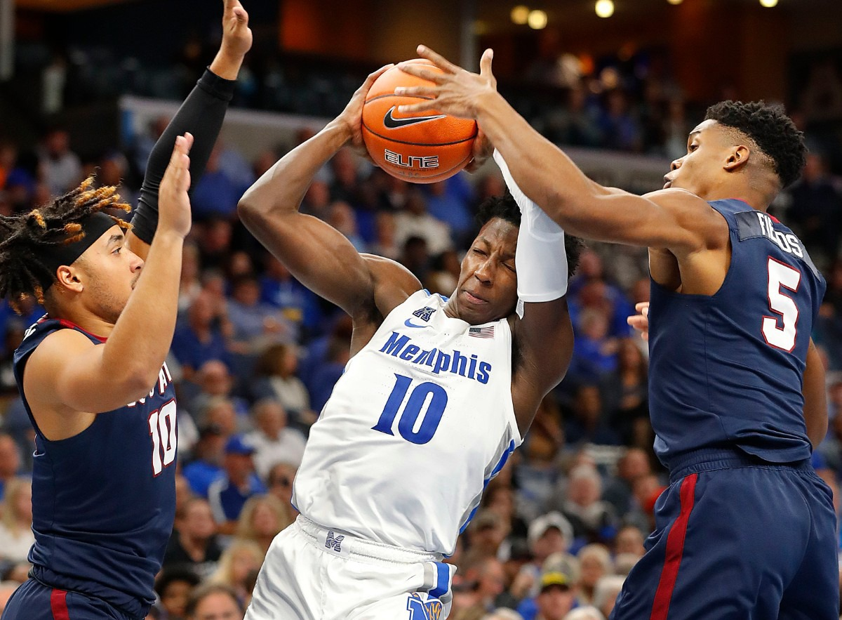 <strong>Memphis guard Damion Baugh (center) drives the lane against South Carolina State's Rahsaan Edwards (left) and Ozante Fields (right) Nov. 5 at FedExForum.</strong> (Mark Weber/Daily Memphian)