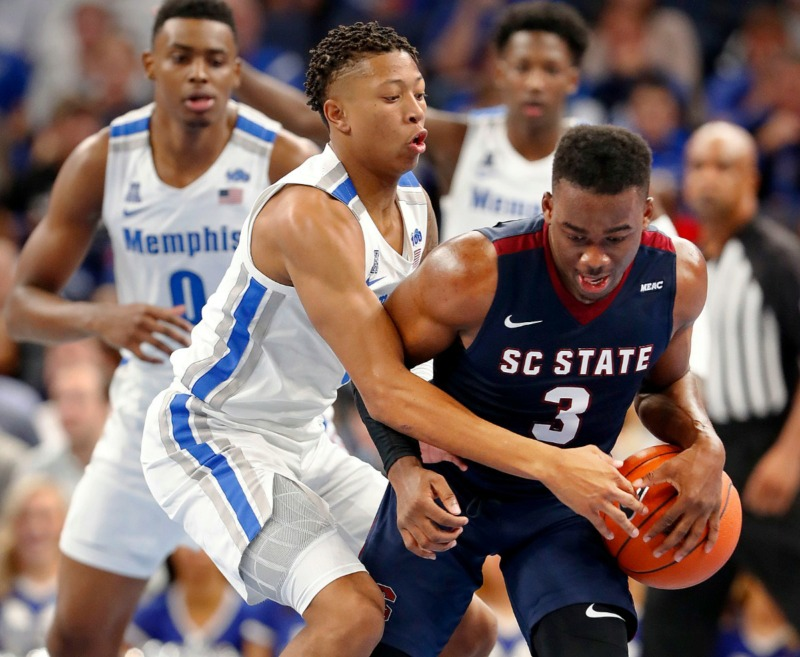 <strong>Boogie Ellis (left) applies pressure to South Carolina State guard Rayshawn Neal (right) Nov. 5 at FedExForum.</strong> (Mark Weber/Daily Memphian)